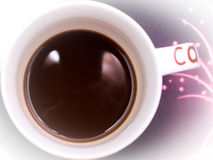 A cup of coffee image with milk on a purple background royalty free stock image