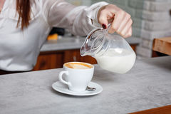 Cup of coffee with milk on the table Stock Photos