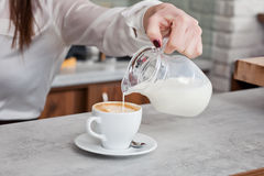 Cup of coffee with milk on the table Stock Images