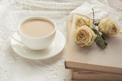 Cup of coffee with milk on windowsill and book with dry rose as decor on lace. Cup of coffee with milk on windowsill and book with dry rose  as decor on lace Royalty Free Stock Photography