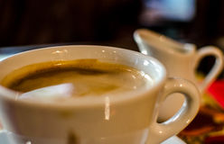 Cup of coffee and milker. Closeup Royalty Free Stock Photo