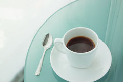 Cup of coffee on a mirror table,office. Cup of coffee on a mirror table Royalty Free Stock Photography