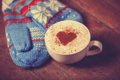 Cup with coffee and mittens Royalty Free Stock Image