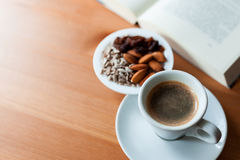 Cup of coffee with mixed nuts Royalty Free Stock Photo