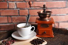 Coffee machines retro. A cup of coffee mixed with retro equipment Stock Image