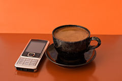 Cup of coffee and mobile phone Royalty Free Stock Images