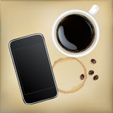 Cup Of Coffee With Mobile Phone Royalty Free Stock Photography