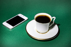 A cup of coffee and mobile phone stock photography