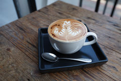 A cup of coffee mocha on wooden Royalty Free Stock Photo