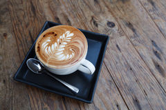 A cup of coffee mocha on wooden Royalty Free Stock Photos