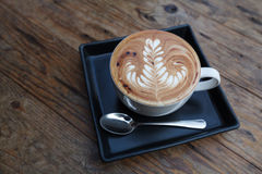 A cup of coffee mocha on wooden Royalty Free Stock Image