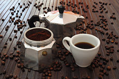 Cup of coffee and moka. Moka pot with a cup of coffee royalty free stock photo