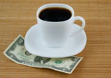 Cup of coffee and money Royalty Free Stock Photography