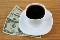 Cup of coffee and money Stock Image