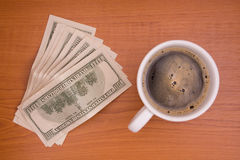 Cup of coffee and money Stock Photography