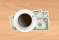 Cup of coffee and money on wooden Stock Images