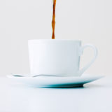 Cup of coffee in the morning. Filling a cup of coffee in the morning Royalty Free Stock Photos