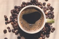 Cup of coffee. Morning cup of coffee,coffee beans Royalty Free Stock Images