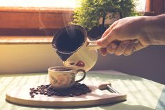 Cup of coffee. Morning cup of coffee,coffee beans Royalty Free Stock Photos