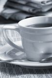 Cup  coffee on a morning paper. Business news Royalty Free Stock Photos