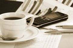Cup  coffee on a morning papers Royalty Free Stock Image