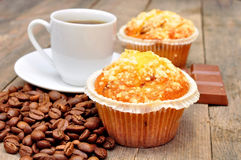 Cup of coffee with muffin Stock Images