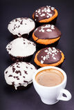 Cup of coffee and muffins in the glaze Royalty Free Stock Image