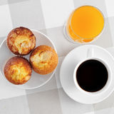Cup of coffee, muffins and orange juice Royalty Free Stock Photos