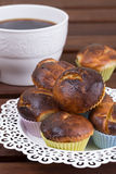 Cup of coffee and muffins Stock Images