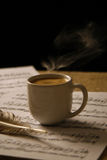 Cup of coffee on a music score. Royalty Free Stock Photos
