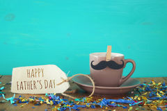 Cup of coffee with mustache. Father& x27;s day concept stock images