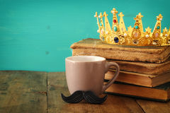 Cup of coffee with mustache and king crown. Father& x27;s day concept Royalty Free Stock Photos