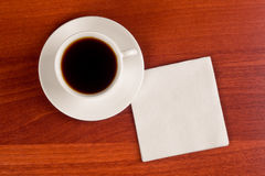 Cup of coffee and napkin Stock Image