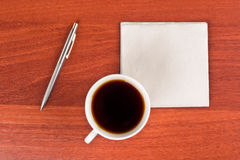 Cup of coffee and napkin Royalty Free Stock Photography