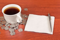 Cup of coffee and napkin Stock Images