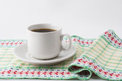 A cup of coffee on a napkin. Stock Image