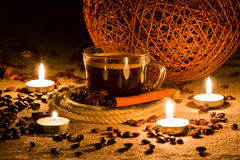 Cup of coffee in natural candle light Stock Images