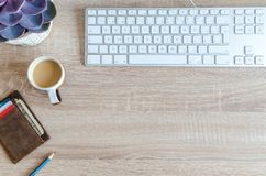 Cup of Coffee Near Keyboard on Table Top Royalty Free Stock Photo