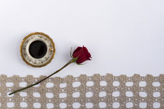 Cup of coffee near a lace with a red rose Stock Photo