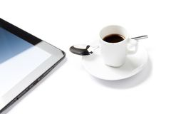 Cup of coffee near a tablet pc, concept of new technology Stock Photography