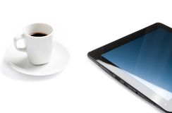 Cup of coffee near a tablet pc, concept of new technology Royalty Free Stock Image