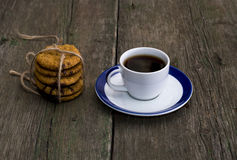 Cup of coffee and nearby linking of oatmeal cookies Stock Photography