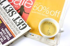 Cup of coffee on newspaper Stock Image