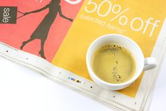 Cup of coffee on newspaper Stock Images