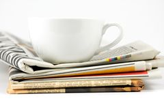 Cup of coffee on newspaper Royalty Free Stock Photos