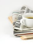 Cup of coffee on newspaper Royalty Free Stock Image