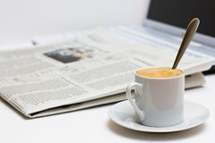 Cup of coffee and newspaper Stock Photos
