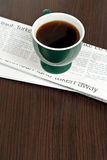 Cup of coffee on newspaper Stock Photo