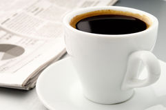 Cup of coffee and a newspaper Stock Images
