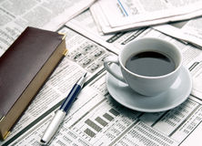 Cup of coffee on the newspaper. Office and business Royalty Free Stock Image